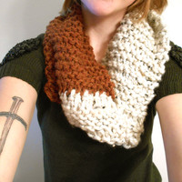Solid or dual color single loop infinity scarf.