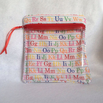 "Kids or Teacher Vinyl see through padded zippered case is 7 1/2"" x 7 3/4"". Ruled ABC materail in bright colors."