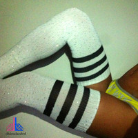 crystallized white thigh high athletic socks with stripes.