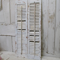 Distressed wooden shutters shabby chic barely pale blue white beach cottage home decor anita spero