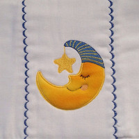 Burpcloth with sleeping moon applique with a star dangling from it's green hat. It can be personalized for an extra charge.