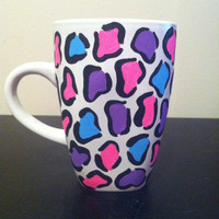 Leopard print coffee cup, purple, pink and blue