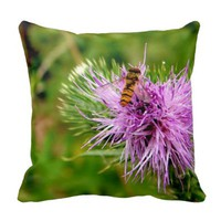 bee on purple flower pillow