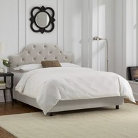 Custom Upholstered Curved Tufted Bed
