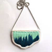 Embroidered abstract pendant in ombre colors of rich emerald green and mint green on a silver ball chain perfect for Spring
