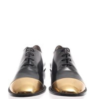 Metallic-toe brogues