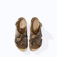 PRINTED LEATHER CROSSOVER SANDAL
