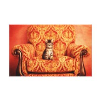 Cute Kitten Sitting on A Big Chair Canvas Print