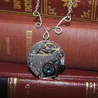 Steam punk blue crystal clock parts necklace by caitlinjohns
