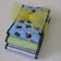 Burp Cloths - choo choo train soft flannel fabrics coordinated with blue ribbon, sewn on diaper