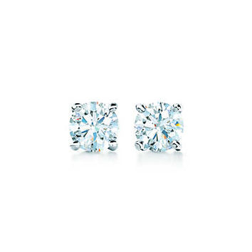Tiffany & Co. - Tiffany solitaire diamond earrings in platinum.