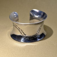 Sterling silver anticlastic cuff bracelet with inspiring wave quote
