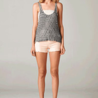 Keep your look unique with the Cute Racerback Tank Top. This sleeveless top features semi-sheer hole cut out design throughout, low racer back, low round neckline, low cut at armhole. Wear with bandeau top and denim shorts.