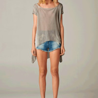 This sleek Devine Thin Knit Tunic Top with grow on you with its simple chic design! This acid washed semi-sheer lightweight knit top features oversize design, scoop neckline, flare high and low hemline, cut for every or beach cover up. Pair with bandeau, d