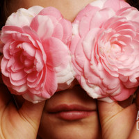 Young Girl Holding Camellia Flowers over Her Eyes Photographic Print by Oliver Strewe at Art.com
