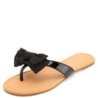 BOW-TOPPED PATENT THONG SANDALS