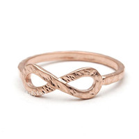 infinity ring, hammered in pink