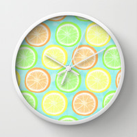 Citrus Wheels (Aqua) Wall Clock by Lisa Argyropoulos | Society6