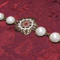 Flower and gears pearl bracelet by caitlinjohns on Etsy