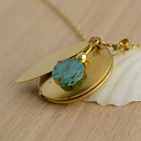 Locket necklace. Gold colored brass necklace.