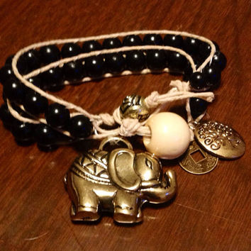 Black and gold hemp wrap elephant charm bracele