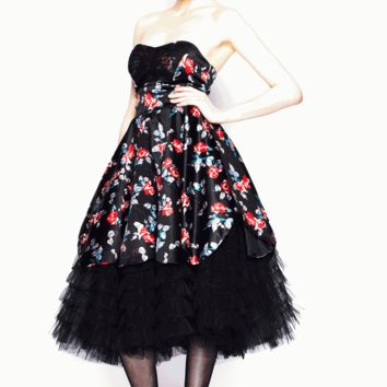 * Stunning ballgown or prom dress.* Black satin with floral print in red, blue, green and grey.* Strapless bodice.* Seams over bust to shape.* Black tulle (netting) over bust.* Wide waistband.* Scallop ''petal'' shaped hem.* Tiered black tulle underskirt e