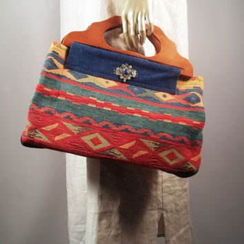 Large hand bag, purse bag,wooden handles.Home decor fabric, tribal,aztec. Lined, 8 inner pockets.Free shipping in the USA.