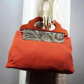 Large hand bag, purse bag,wooden handles.Home decor fabric, burnt orange. Lined, 8 inner pockets.Free shipping in the USA.