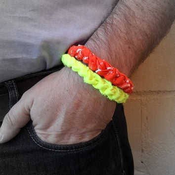 2 mens surfer bracelets. Braided fabric bracelets for the beach. Neon orange and neon yellow bracelets for the summer.