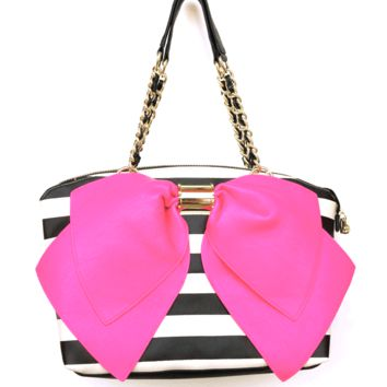 Stay a fashion beat ahead of the trend with this faux-leather BOW-LICIOUS Tote by Betsey Johnson. Featuring a flirty bow and signature hardware, it's certain to set any look aflutter.