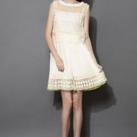Cream pleated dress with crochet hemline