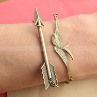Mockingjay bracelet and Arrow Bracelet by luckyvicky on Etsy