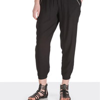 Black jogger pants with zippers