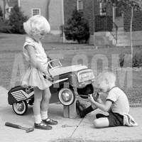 Children on Suburban Sidewalk, Boy Playing As Mechanic, Oiling Toy Pedal Car Photographic Print by H. Armstrong Roberts at Art.com