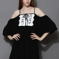 Black off shoulder dress with frill hem