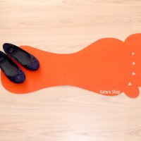 Foot rug silhouette. Modern floor mat with foot shape.