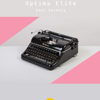 RESERVED /// 1955 Optima Elite Typewriter. Mint condition. Refurbished & fully working. Portable. East Germany. Glossy black. With case.