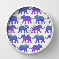 Follow The Leader - Painted Elephants in Royal Blue, Purple, & Mint Wall Clock by Tangerine-Tane | Society6