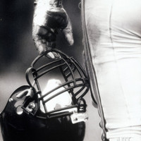 Low Angle View of An American Football Player Holding a Helmet Photographic Print at Art.com