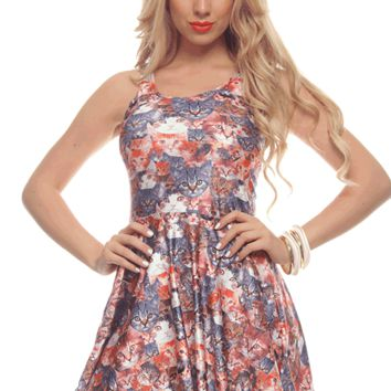 Featuring mega stretch fabrication, a scoop neckline, cats print throughout, slip on style, thick shoulder straps, racerback, a-line skirt and finish with raw bottom hemline. Unlined.