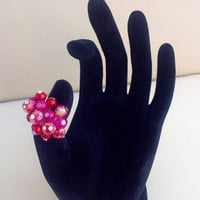 Adjustable crystal and glass beaded ring in fuchsia and red
