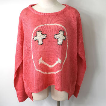 Coral Happy Face Cross Sweater