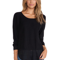 Rye Asymmetric Hem Sweater in Black