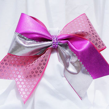 Cheer bow -  Pink striped with pink sequins and a pink rhinestone center. Cheerleader bow - dance bow - Cheerleading bow