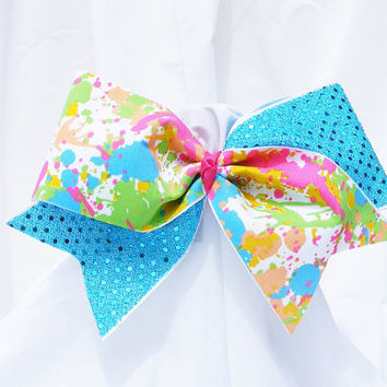 Cheer bow - Multi colored neon paint splatter with blue sequins. cheerleader bow - dance bow -cheerleading bow