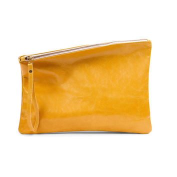 Yellow leather clutch by Leah Lerner