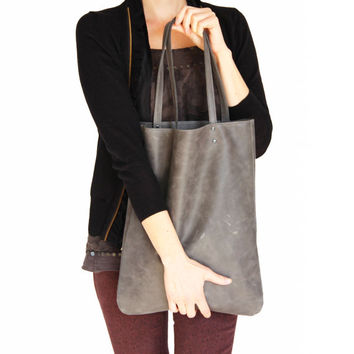 Grey leather tote bag by Leah Lerner