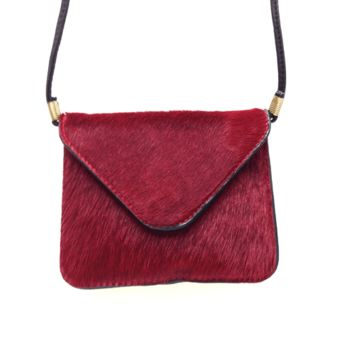 Elevate your elegant style with this Sophisticate Scene Genuine Leather & Pony Hair Crossbody Bag! This small purse features textured pony hair and leather, front flap with magnetic snap button closure, full interior lining, and finished with thin shoulder