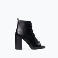 High heel peep toe ankle boot