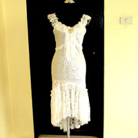 vintage inspired white satin dress with ruffles of lace and vintage motifs...
